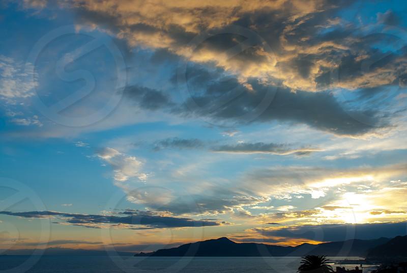 Sunset over Tigullio gulf shot by Cavi di Lavagna Genoa province Italy photo
