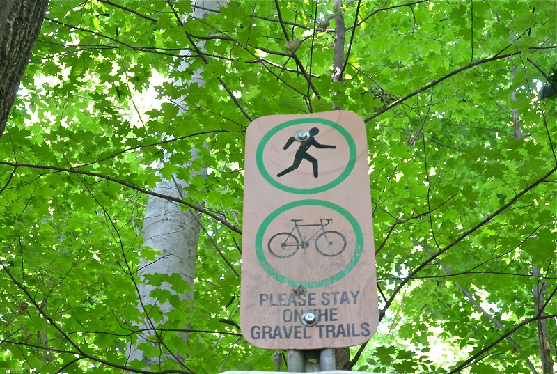 please stay on the gravel trails signage photo