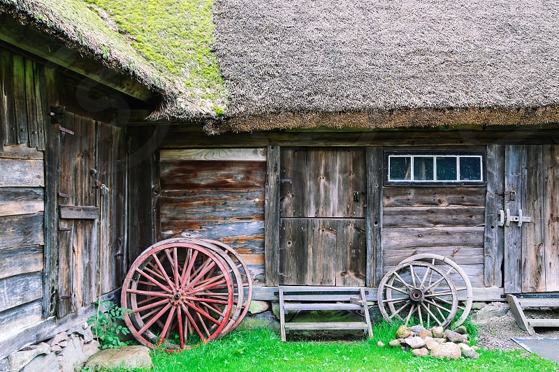 Farm farm lifestyle  old house building wheels vintage rustic house farming architecture  facade photo