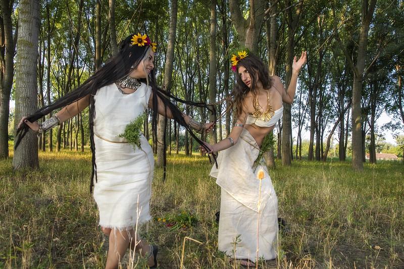 Pagan Woman Dancing and Celebrating summer solstice at sunrise photo