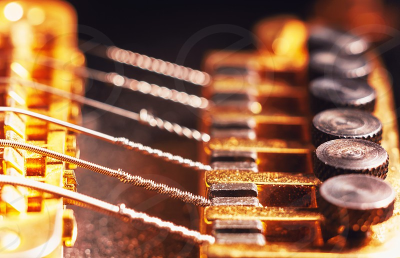 Details of an electric guitar fine tuners macro view.  photo