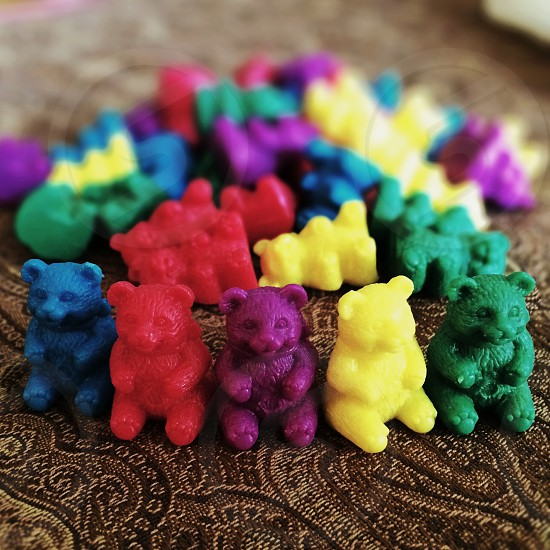 red blue purple yellow and green plastic bear toy photo