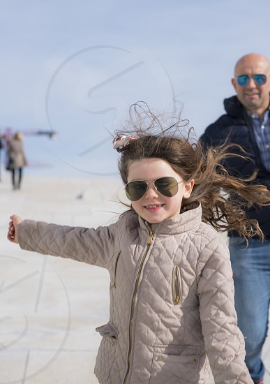 Nicoline playing with her dad on top of the opera house in Oslo photo