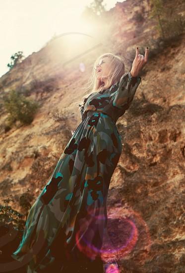 blonde model hippie rock rocker lens flare day blonde long hair woman model sunny happy rocks nature dress photo