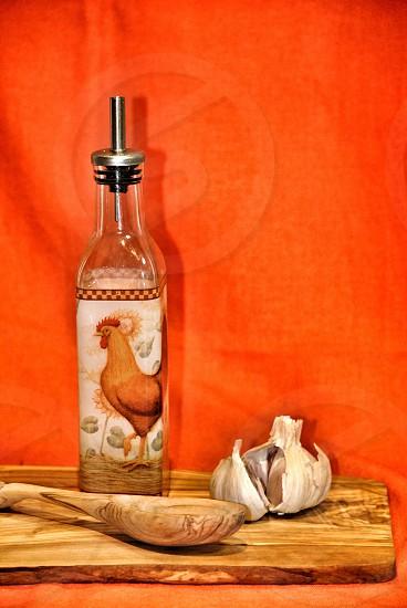 chicken labeled bottle beside garlic clove photo