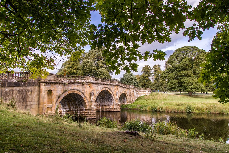 Stone bridge over the river derwent on the Chatsworth Estate photo