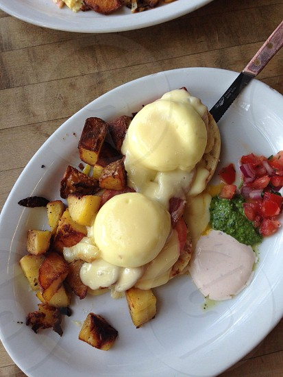 Eggs Benedict with home style potatoes  photo