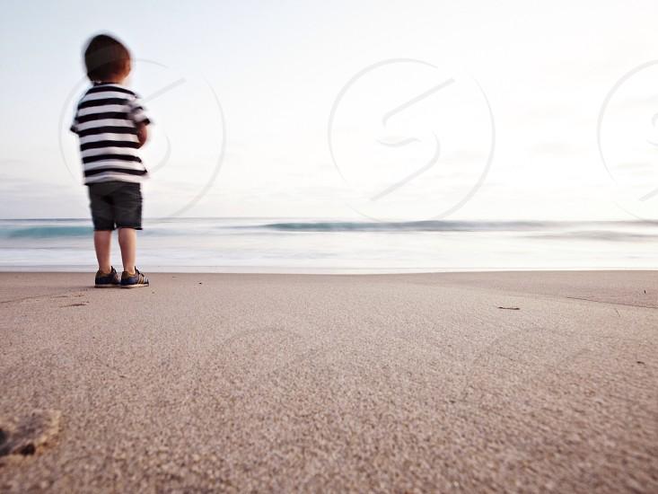 boy in seashore  photo