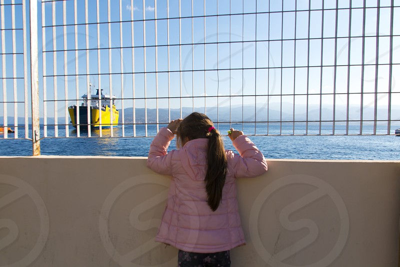 Little girl waits for the ferry boat photo