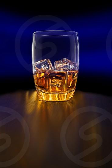 "Whiskey whisky scotch bourbon rye rocks ""on the rocks"" glass tumbler ice blue table drink drinks  photo"