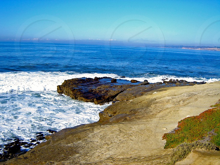 Waves and rocks on the San Diego Coast photo