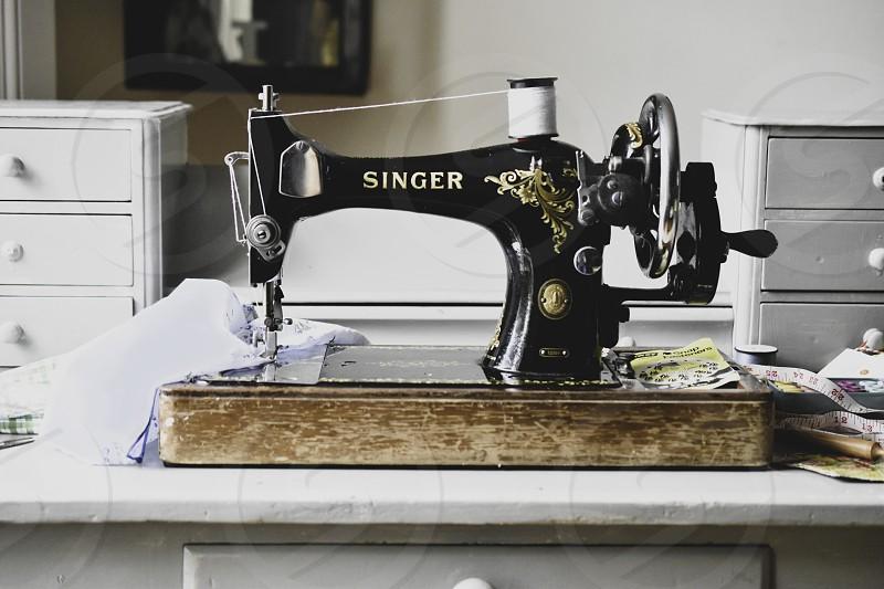 Vintage sewing machine on desk photo