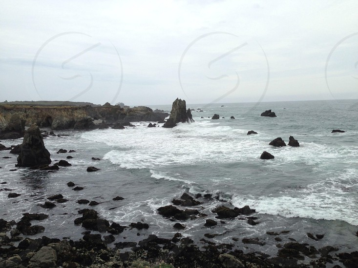 seashore water wave and rock view photo