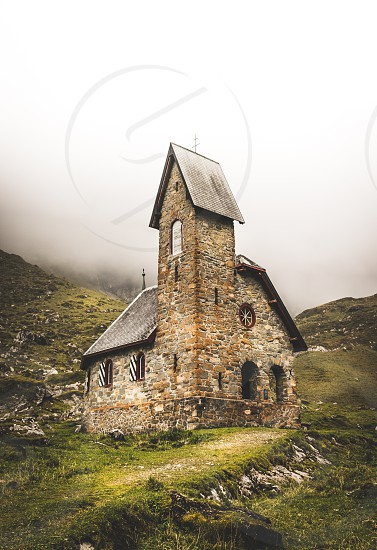 Little churuch in the mountains of Switzerland photo