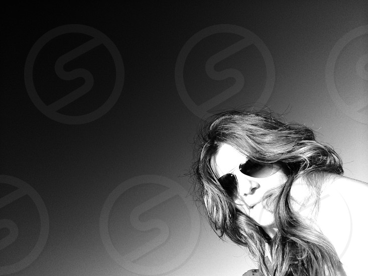 grayscale photography of woman wearing sunglasses photo