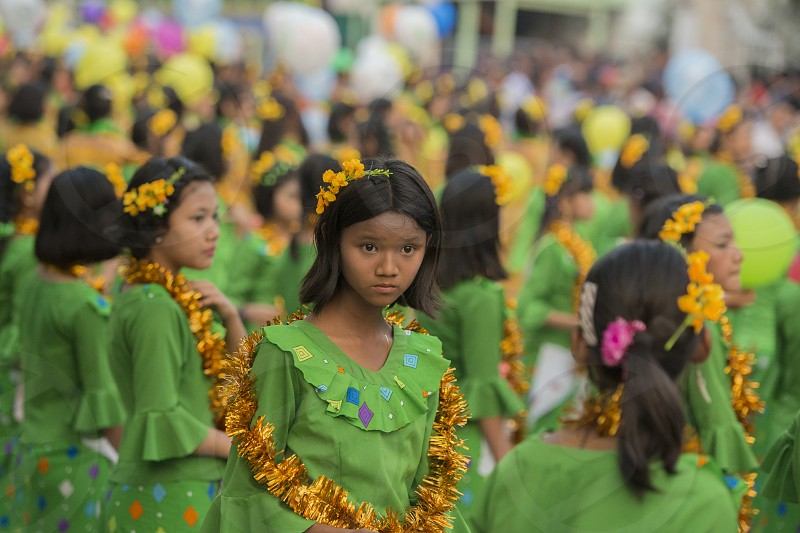 Traditional Dance Girls at the Thingyan Water Festival at the Myanmar New Year in the city centre of Mandalay in Manamar in Southeastasia. photo