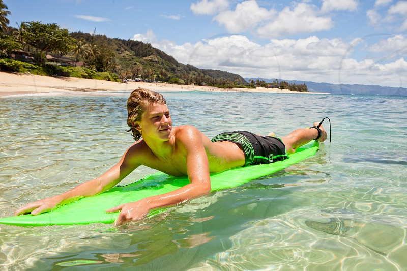 Cute Teen surfer in Hawaii Sunset Beach Oahu photo