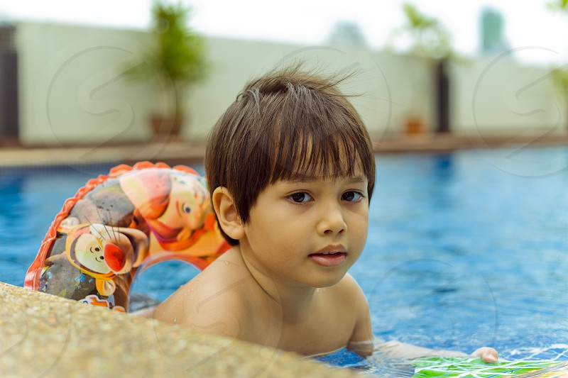 Mixed race asian boy at the swimming pool summer day kid fun activity pool travel hotel resort outdoor thithi thitiwin benbdprod photo