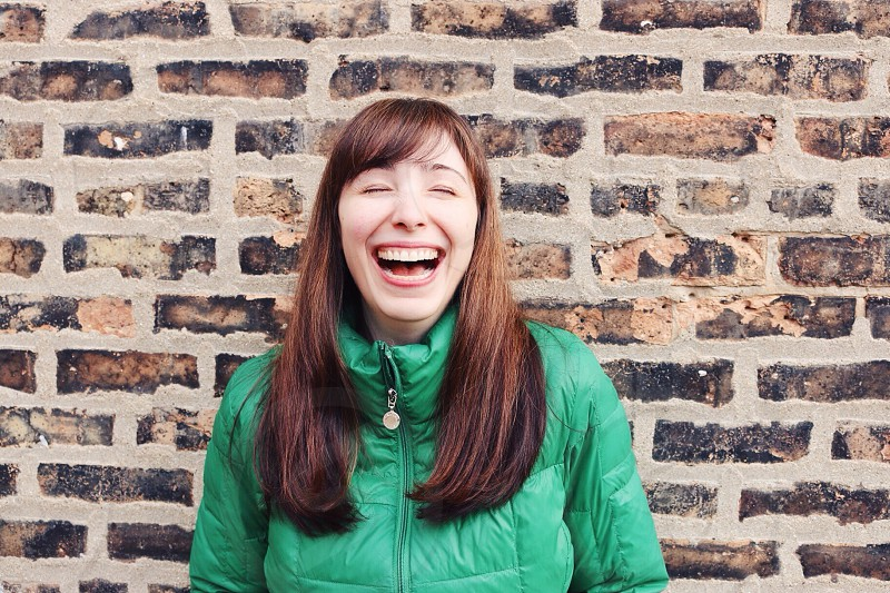 woman wearing green jacket smiling photo