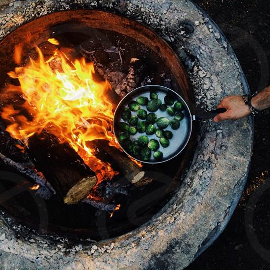 cooking pot on the round concrete bonfire photo