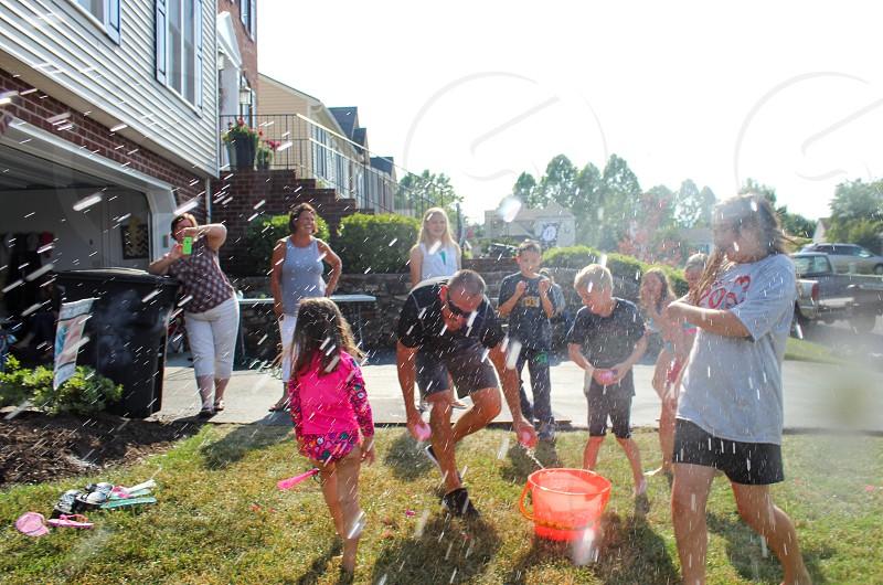 Summer fun balloon fight water balloon wet fun friends outdoors photo