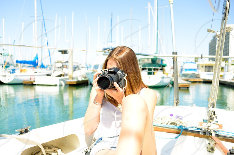 woman with brown long hair holding black dslr camera photo