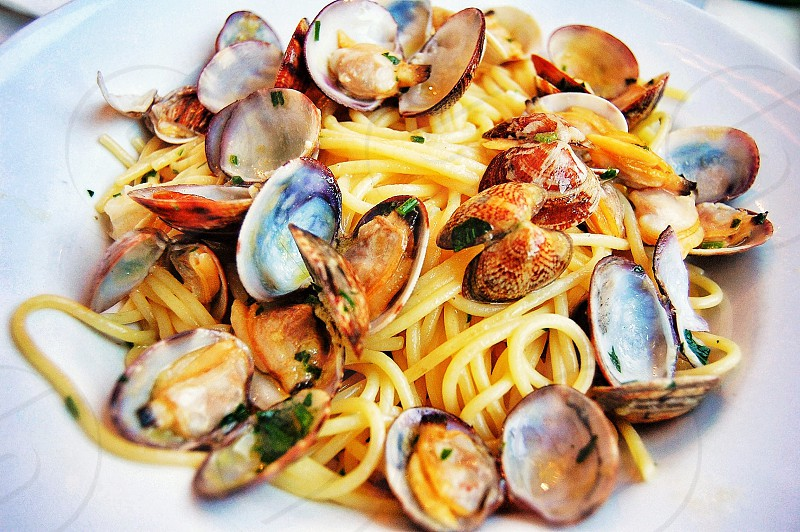 seafood pasta on white ceramic bowl photo