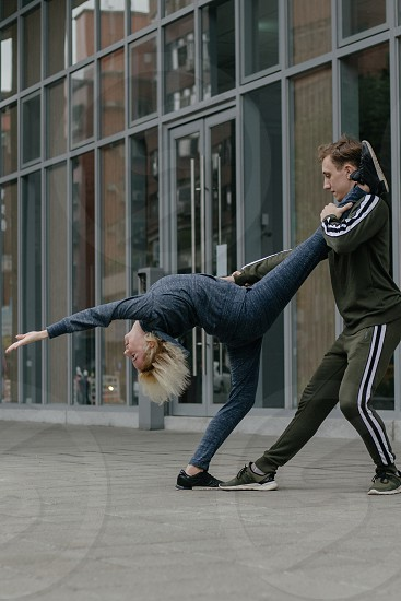 Couple do sport dance training in the city street photo