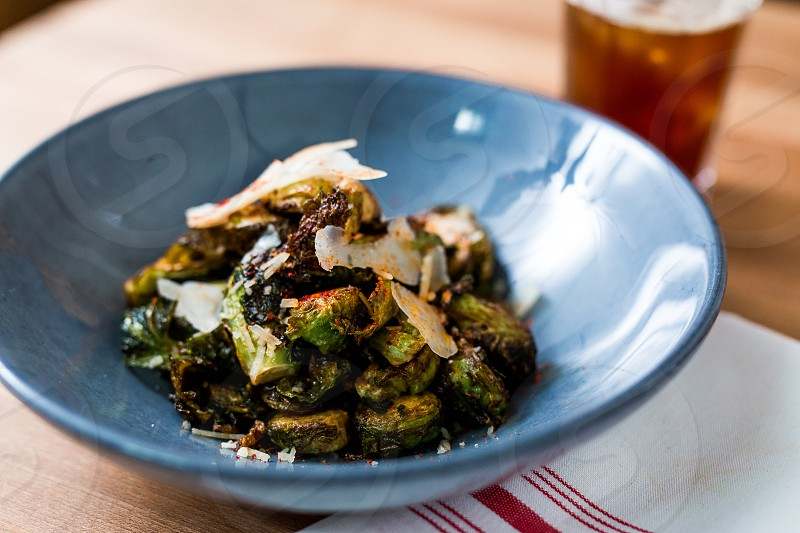 Sautéed Brussels sprouts with spices and parmesan cheese. photo
