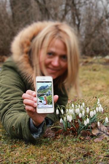Woman using mobile app photo