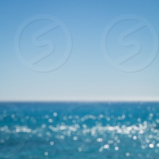 Sparkly blue sea. defocused bokeh silver blue white photo