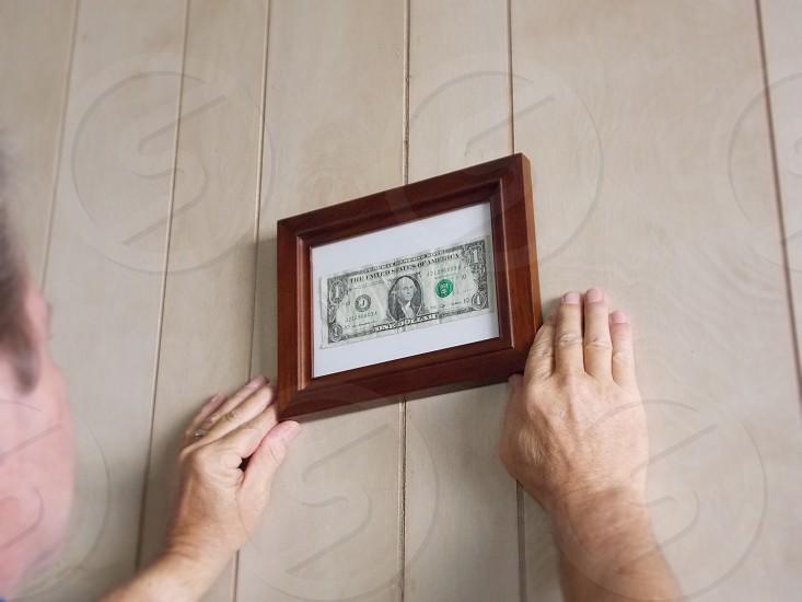 brown framed 1 us dollar wall decor photo