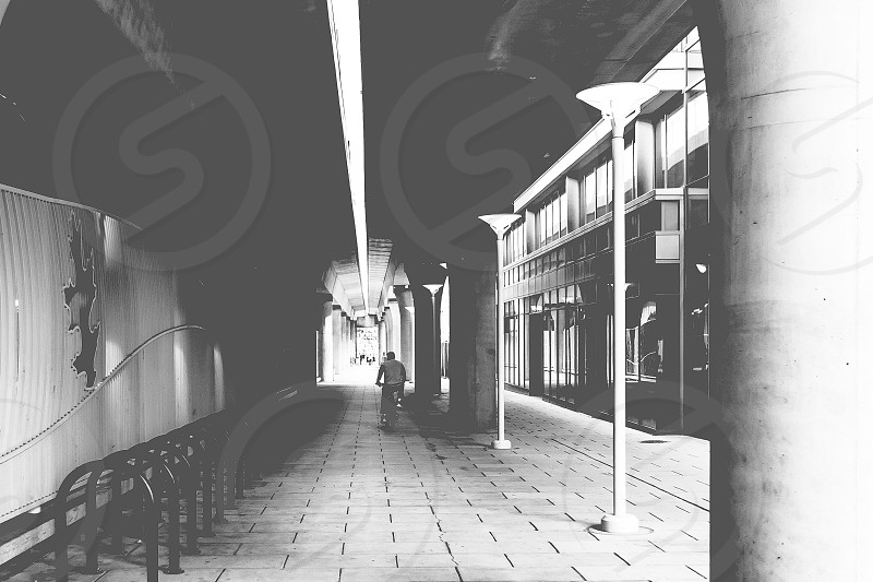man with bicycle on covered alley photo