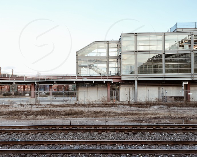 white and building in front of train rail during daytime photo
