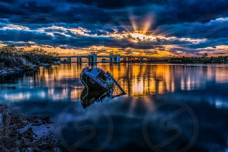 Sunset sunken boat bridge  photo