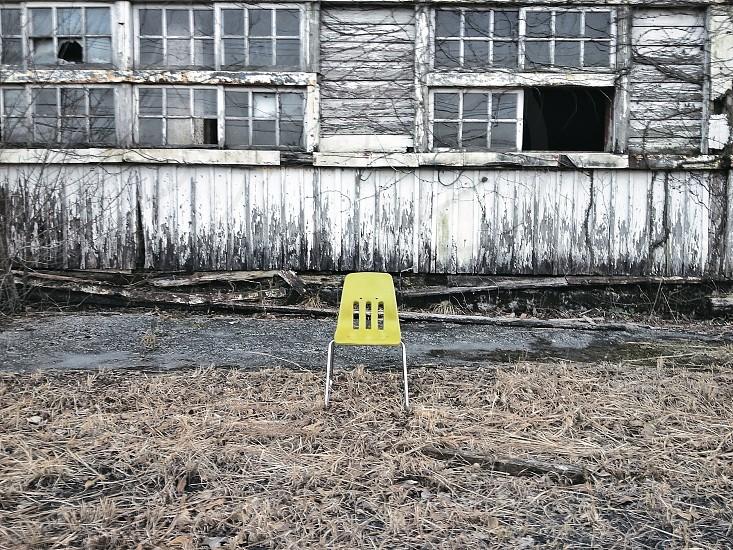 yellow plastic chair photo