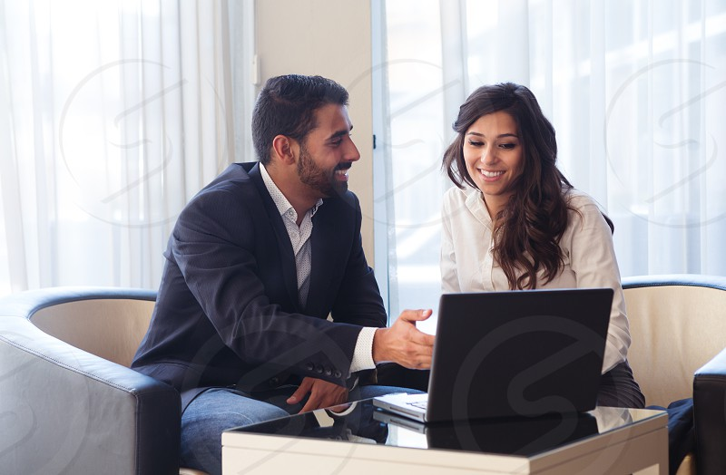 couple team woman man suit business young laptop office latin hispanic photo