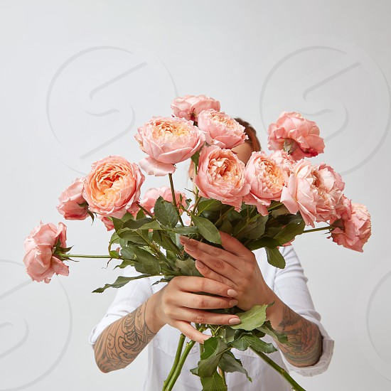 woman holding a beautiful bouquet of pink roses valentines day photo