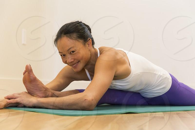 Flexible Yogi stretches in the studio photo