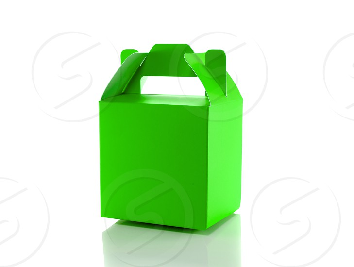 green gift box isolated on white photo