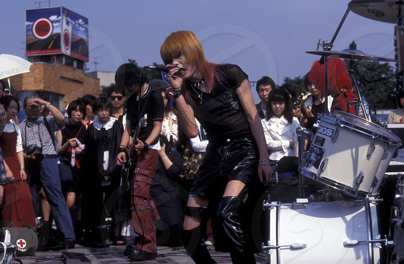 a Japanese Youth Punk Band plays on a square in the City of Tokyo in Japan in Asia