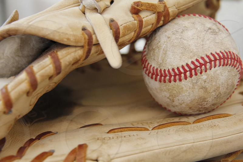 Baseball glove and ball waiting for the next time they can hit the field for some action photo