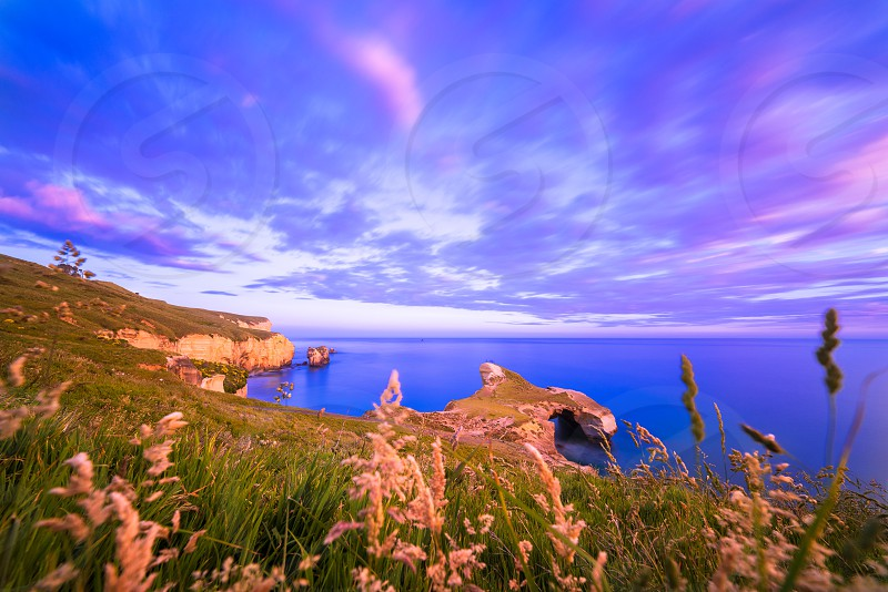 Tunnel Beach at sunset in long exposure photo