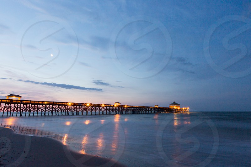 The pier at Folly Beach before the sun comes up.  Long exposure. photo