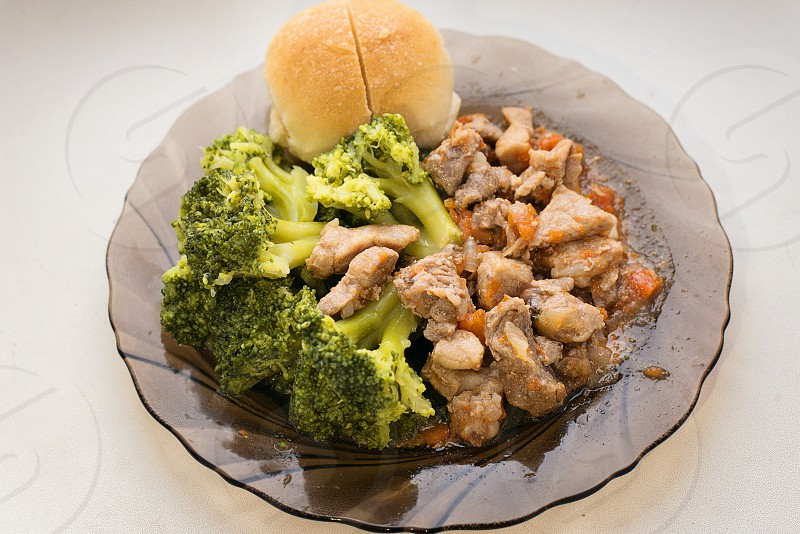 meat pork stew onions carrots vegetables spices broccoli bread lunch on a plate daylight juicy tasty fresh hearty homemade cooking food photo