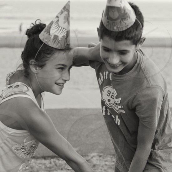 girl and boy in party hats photo
