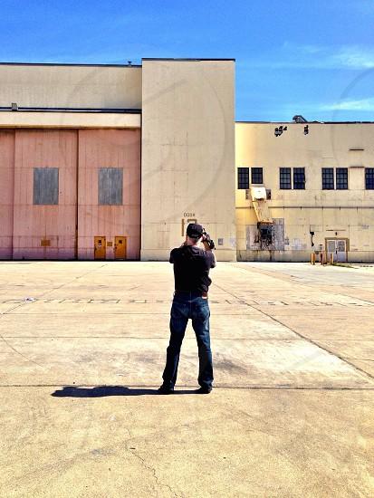 man looking at the warehouse photo