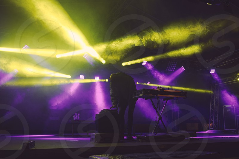 DJ on the Floodlit Stage Filled with Smoke photo
