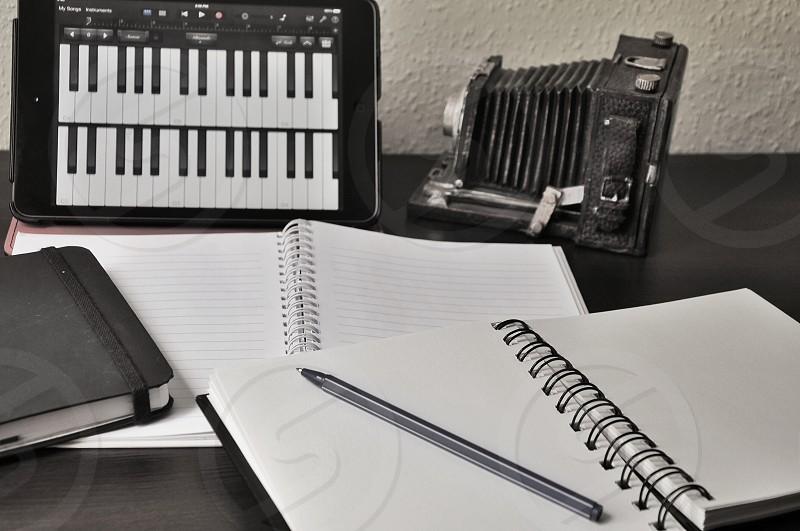 black pen on spiral notebook photo