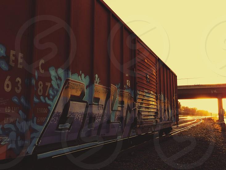 red train wagon with graffiti photo